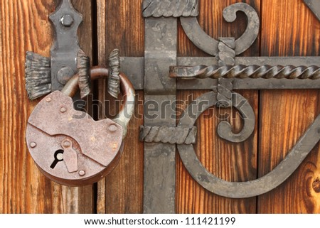 wooden gate old padlock on a wooden door - stock photo