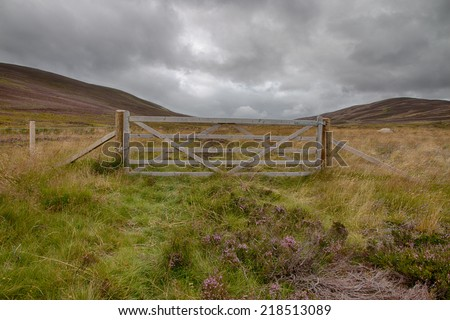 Wooden gate to keep cattle behind the fence in the Highlands of Scotland, HDR version - stock photo