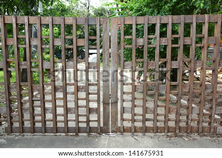 Wooden Gate with key and chain lock - stock photo