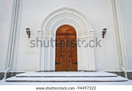 wooden gates of old withe church