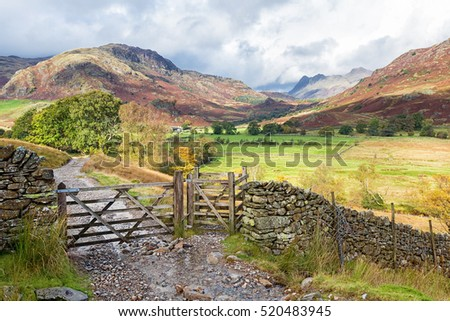 Wooden gateway in Little Langdale, the Lake District, England.The Langdale Pikes can be seen in the background.