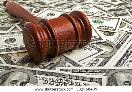 Wooden gavel and American dollars - stock photo