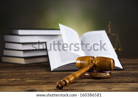 Wooden gavel and books  - stock photo