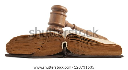Wooden gavel and open old book isolated on a white background - stock photo