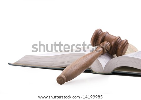 Wooden gavel and open textbook.  Isolated on white. - stock photo