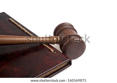 Wooden gavel and vintage book on a white background  - stock photo
