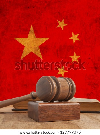 Wooden gavel and vintage China flag - stock photo