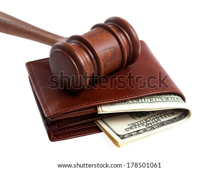Wooden gavel and wallet with money isolated on a white background - stock photo