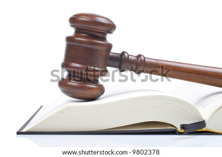 Wooden gavel from the court and law book isolated on white background. Shallow DOF - stock photo