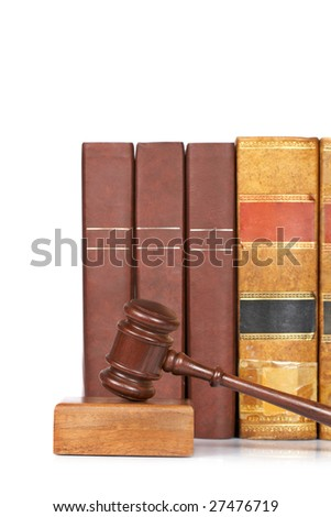 Wooden gavel from the court and old law books reflected on white background. Shallow depth of file - stock photo
