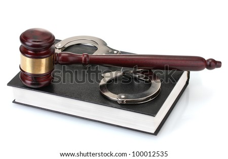 wooden gavel, handcuffs and book isolated on white - stock photo