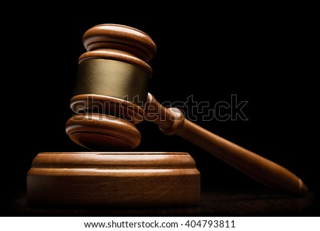 Wooden gavel isolated on black - stock photo
