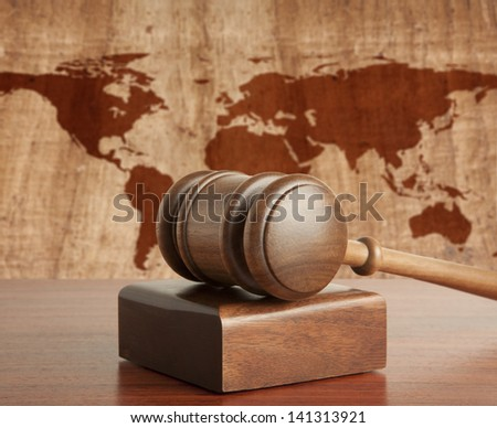 Wooden gavel on a background map of the world - stock photo