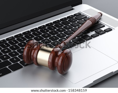 wooden gavel on laptop - stock photo