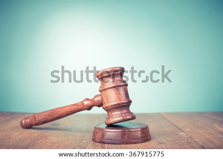 Wooden gavel on table. Symbol of justice. Retro style filtered photo - stock photo