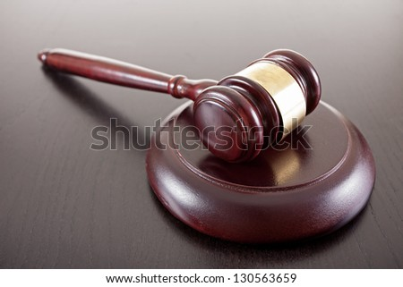 wooden gavel on top of table