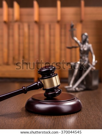 Wooden gavel on wooden table, law concept - stock photo