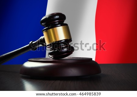 Wooden gavel with French flag in background. Justice and law symbol