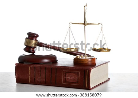 Wooden gavel with justice scales and book on white background - stock photo