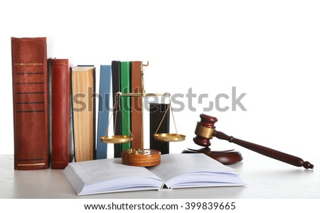 Wooden gavel with justice scales and books on white background - stock photo