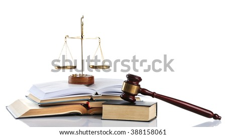 Wooden gavel with justice scales and open books, isolated on white - stock photo
