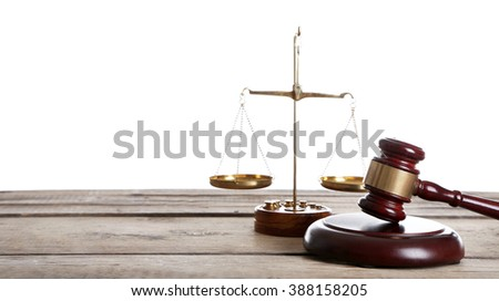 Wooden gavel with justice scales on white background - stock photo