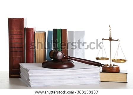 Wooden gavel with justice scales, stacks of documents and books on white background - stock photo