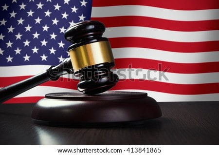 Wooden gavel with USA flag in background. Justice and law symbol - stock photo