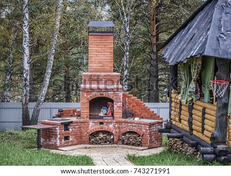 Wooden Gazebo And Outdoor Brick Oven In Backyard
