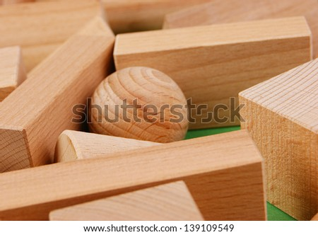wooden geometric shapes on a green background - stock photo