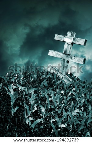 Wooden grave cross on background of the night sky storm - stock photo