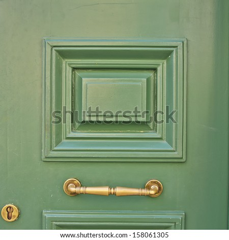 wooden green door closeup - stock photo