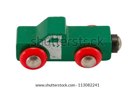 Wooden green retro toy car isolated on white background. - stock photo