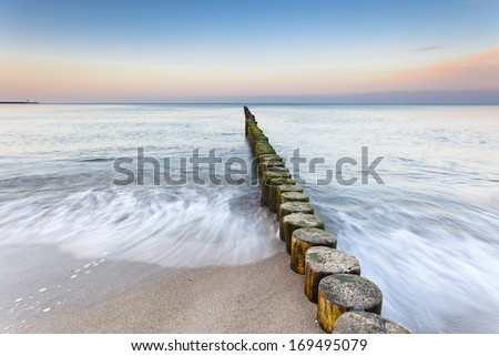 wooden groynes at the beach of german baltic sea  - stock photo