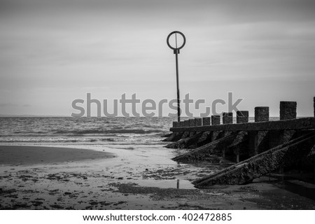 Wooden Groynes Pillers at Beach in Vintage Black and White