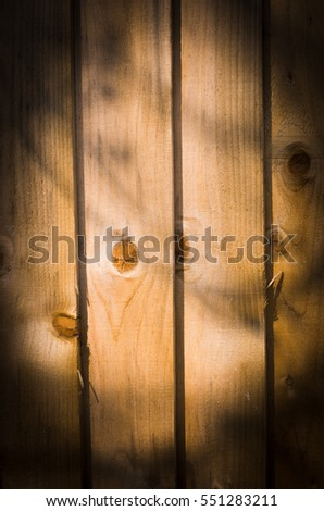 Wooden grunge, old, aged background lighting by the Sun
