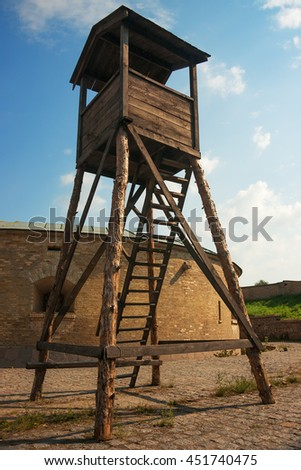 wooden guard tower in old fortess - stock photo