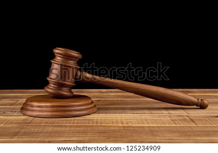 wooden hammer on a black background - stock photo