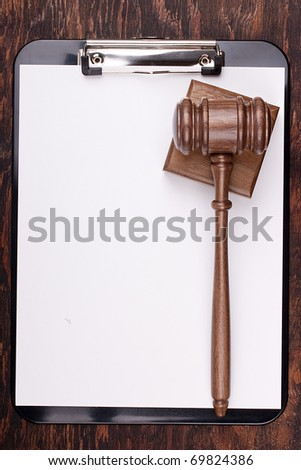 Wooden hammer used in court and in auctions. Add your text to the background. - stock photo