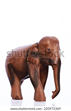 Wooden hand made elephant isolated on white - stock photo