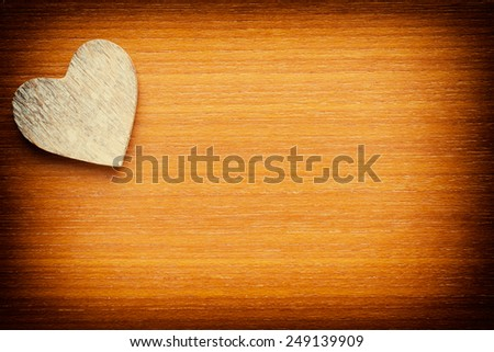 Wooden heart on a grunge wooden background - stock photo