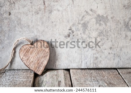 wooden heart on a rustic   background - stock photo