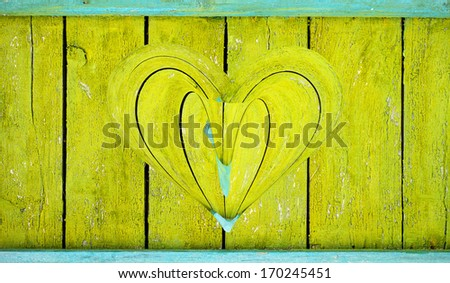 wooden heart on a wooden background