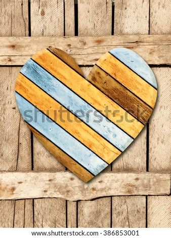 Wooden heart on old wood boards - stock photo