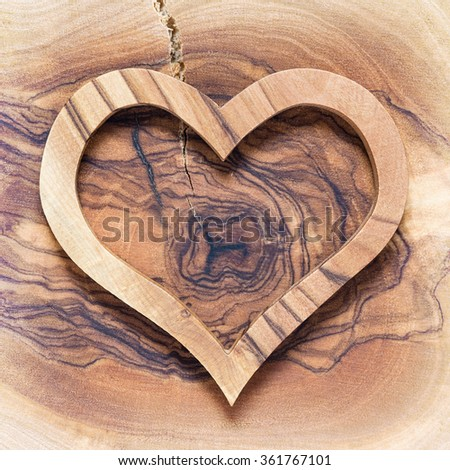 wooden heart on wooden background, white vignette, lot of copyspace