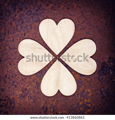 Wooden heart pattern on old rusted background.  - stock photo