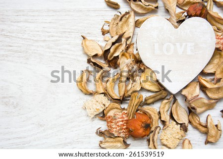 Wooden heart with the word love written - stock photo