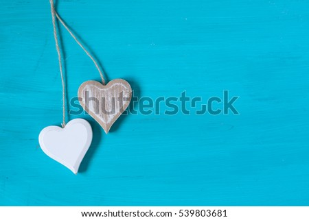 wooden hearts on a blue background