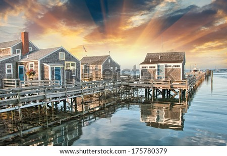 Wooden Homes over water. Beautiful view at summer sunset. - stock photo