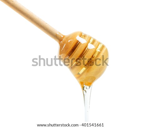 Wooden honey dipper with honey isolated on white background - stock photo